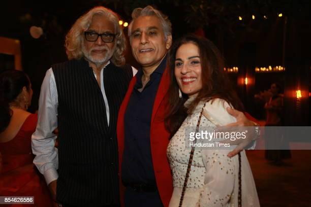 Filmmakerdesigner Muzaffar Ali and Navin Ansal during an art exhibition organised by veteran artist Satish Gujral on September 22 2017 in New Delhi...