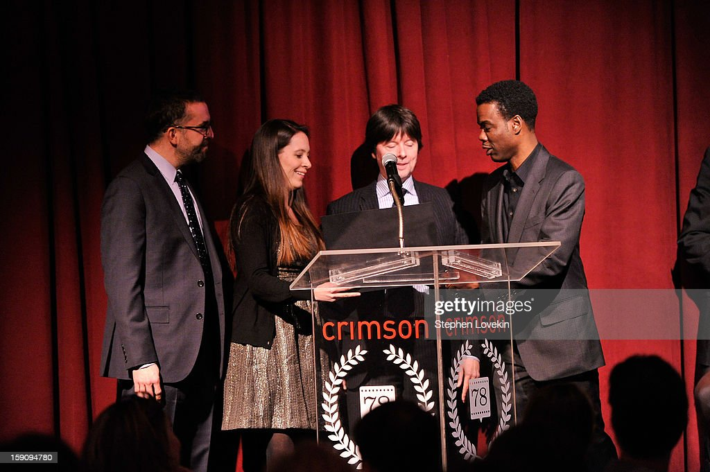 Filmmakers David McMahon, Sarah Burns, and Ken Burns speak on stage with comedian Chris Rock at the 2012 New York Film Critics Circle Awards at Crimson on January 7, 2013 in New York City.