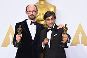 Filmmakers James GayRees and Asif Kapadia winners of the Best Documentary Feature award for 'Amy' pose in the press room during the 88th Annual...