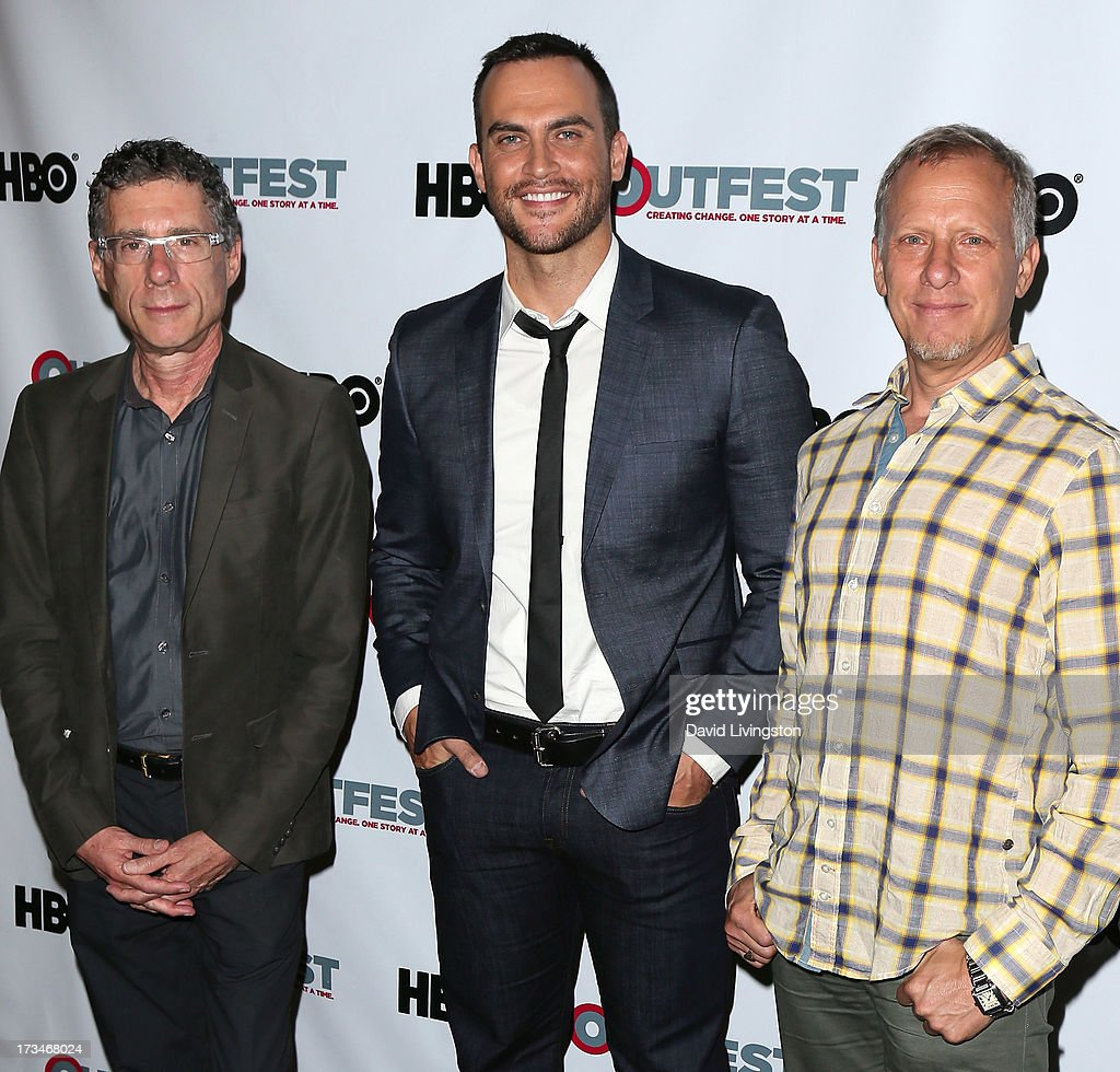 Filmmakers Jeffrey Friedman (L) and Rob Epstein (R) pose with actor Cheyenne Jackson (C) at the 2013 Outfest Film Festival's amfAR panel at the DGA Theater on July 14, 2013 in Los Angeles, California.