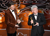 Filmmakers Nicholas Reed and Malcolm Clarke accept the Best Documentary Short Subject award for 'The Lady In Number 6' onstage during the Oscars at...