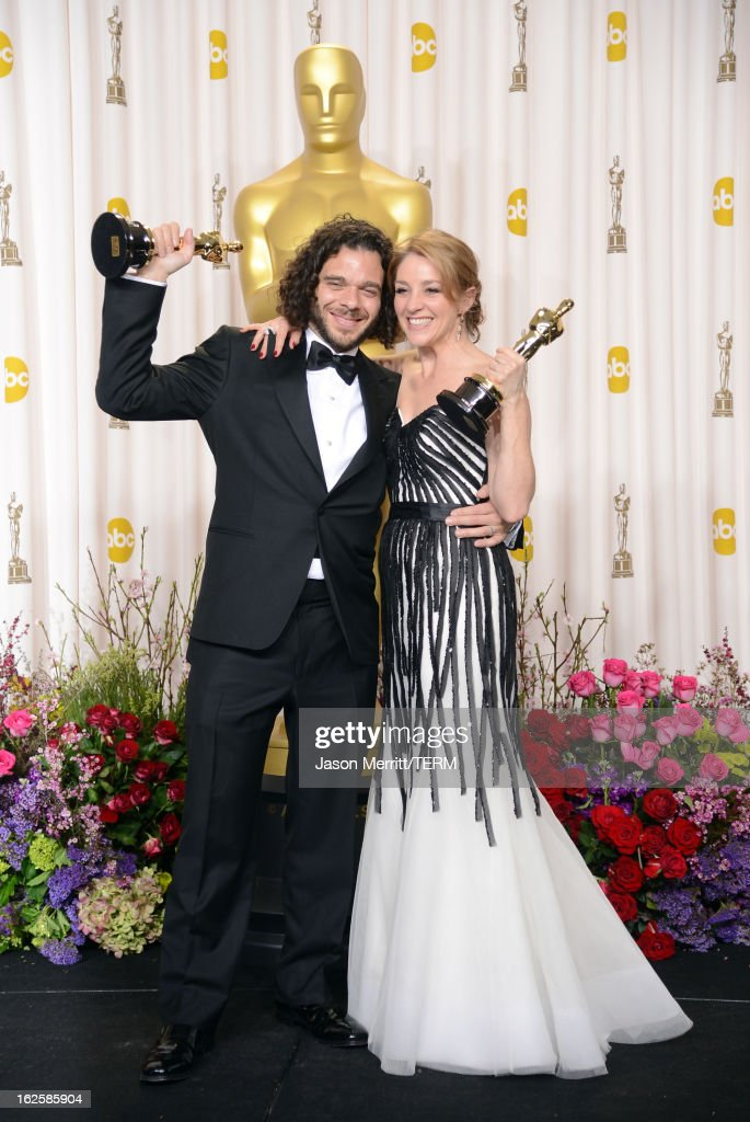 Filmmakers Sean Fine and Andrea Nix Fine, winners of the Best Documentary – Short Subject award for 'Inocente,' pose in the press room during the Oscars held at Loews Hollywood Hotel on February 24, 2013 in Hollywood, California.