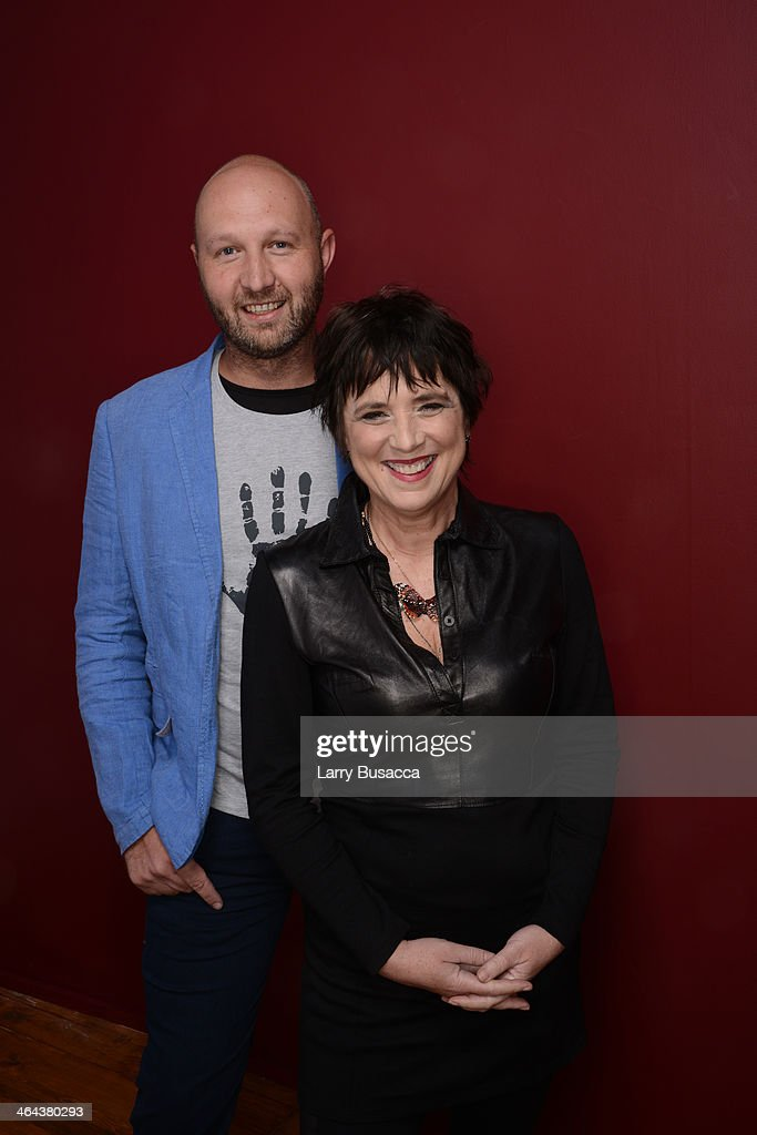 Filmmakers Tony Stroebel and <a gi-track='captionPersonalityLinkClicked' href=/galleries/search?phrase=Eve+Ensler&family=editorial&specificpeople=203150 ng-click='$event.stopPropagation()'>Eve Ensler</a> pose for a portrait during the 2014 Sundance Film Festival at the Getty Images Portrait Studio at the Village At The Lift Presented By McDonald's McCafe on January 22, 2014 in Park City, Utah.