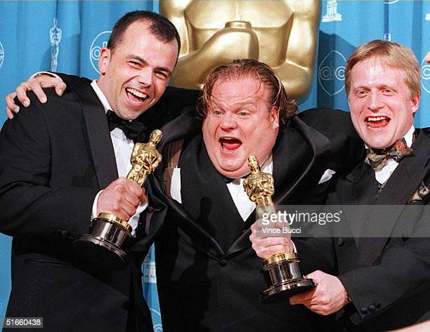 Filmmakers Tyron Montgomery and Thomas Stellmach pose with comedianactor Chris Farley after they won the Oscar for best animated short film for...