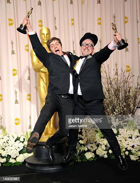 Filmmakers William Joyce and Brandon Oldenburg winners of the Animated Short Film Award for 'The Fantastic Flying Books of Mr Morris Lessmore' jump...