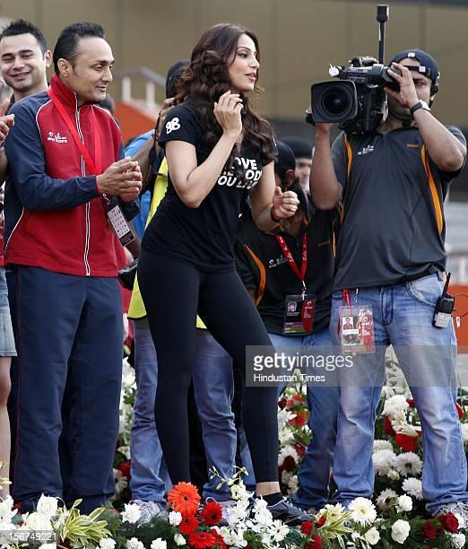 ' NEW DELHI INDIA SEPTEMBER 30 Filmstars Bipsha Basu and Rahul Bose at 5th Airtel Delhi Half Marathon at Jawahar Lal Nehru Stadium on September 30...