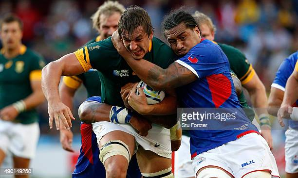 Filo Paulo of Somoa grabs hold of Eben Etzebeth of South Africa during the 2015 Rugby World Cup Pool B match between South Africa and Samoa at Villa...