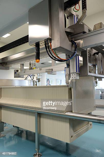 Filter panels used to separate the protein in the early stages of producing Privigen liquid intravenous immunoglobulin pass through an automated...