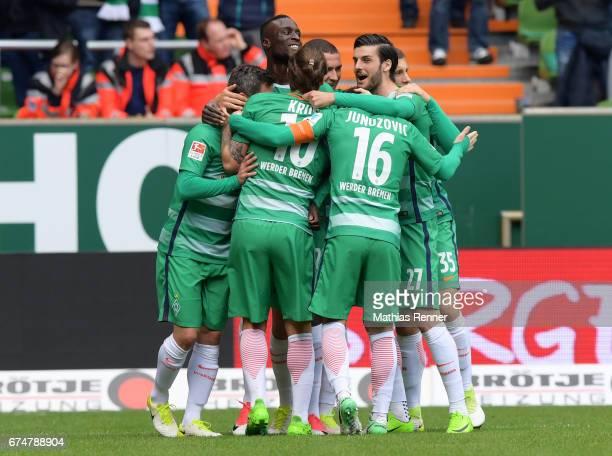 Fin Bartels Lamine Sane Max Kruse Zlatko Junuzovic Florian Grillitsch and Milos Veljkovic of Werder Bremen celebrate after scoring the 20 during the...