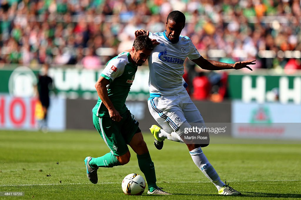 Fin Bartels (L) of Bremen and Joel Matip of Schalke battle for the ball during the Bundesliga match between SV Werder Bremen and Schalke 04 at Weserstadion on August 15, 2015 in Bremen, Germany.