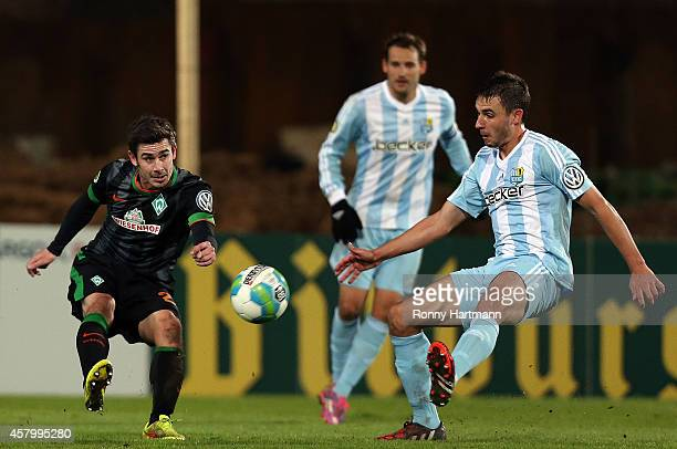 Fin Bartels of Bremen and Kevin Conrad of Chemnitz battle for the ball during the DFB Cup second round match between Chemnitzer FC and Werder Bremen...