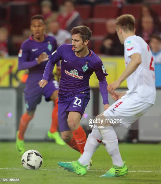 Fin Bartels of Bremen and Lukas Kluenter of Koeln battle for the ball during to the Bundesliga match between 1 FC Koeln and Werder Bremen at...