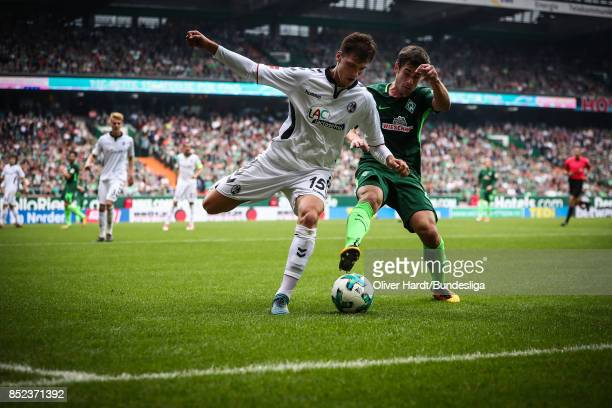 Fin Bartels of Bremen and Pascal Stenzel of Freiburg compete for the ball during the Bundesliga match between SV Werder Bremen and SportClub Freiburg...