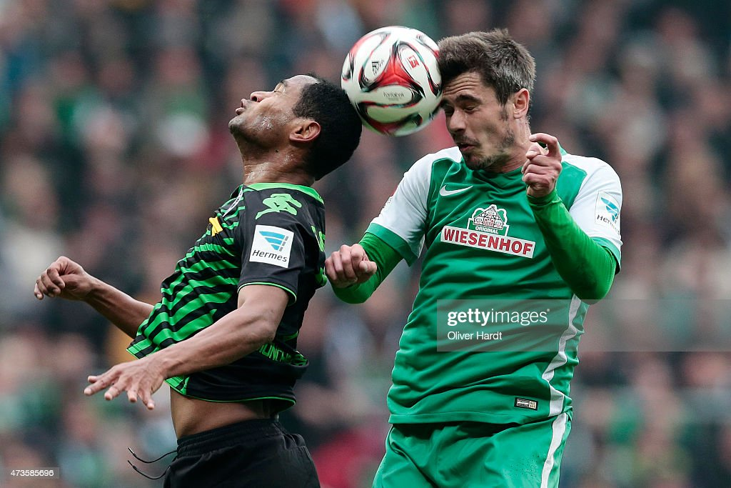 Fin Bartels of Bremen and Raffael of Moenchengladbach compete for the ball during the First Bundesliga match between SV Werder Bremen and Borussia...