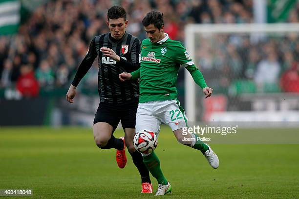 Fin Bartels of Bremen and Tobias Werner of Augsburg compete for the ball during the Bundesliga match between SV Werder Bremen and FC Augsburg at...