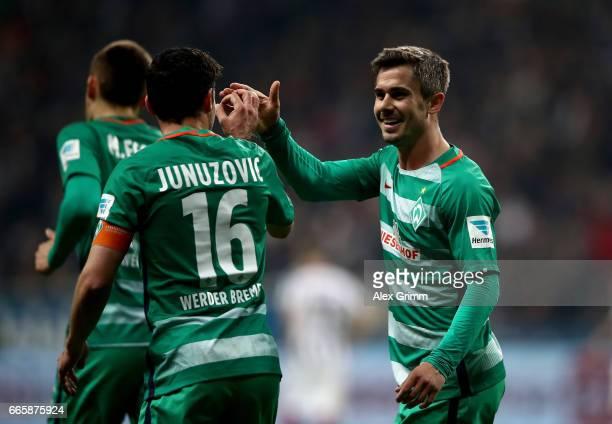 Fin Bartels of Bremen celebrate with team mate Zlatko Junuzovic after he scores the 2nd goal during the Bundesliga match between Eintracht Frankfurt...