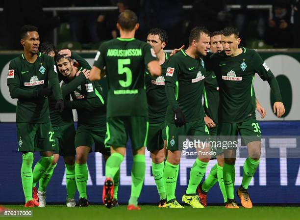 Fin Bartels of Bremen celebrates scoring the first goal with teamates during the Bundesliga match between SV Werder Bremen and Hannover 96 at...
