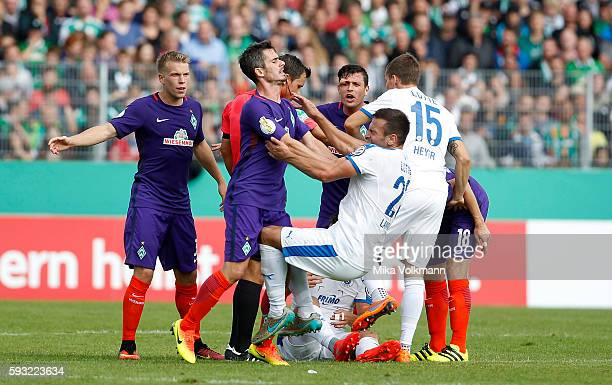 Fin Bartels of Bremen fouls Alexander Langlutz of Lotte and gets the red card during the DFB Cup match between Sportfreunde Lotte and SV Werder...