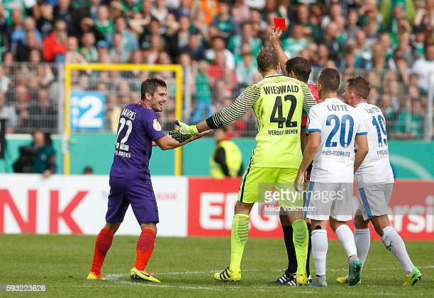 Fin Bartels of Bremen gets the red card during the DFB Cup match between Sportfreunde Lotte and SV Werder Bremen at the Frimo Stadion on August 21...