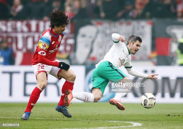 Fin Bartels of Bremen is challenged by Andre Ramalho of Mainz during the Bundesliga match between 1 FSV Mainz 05 and Werder Bremen at Opel Arena on...