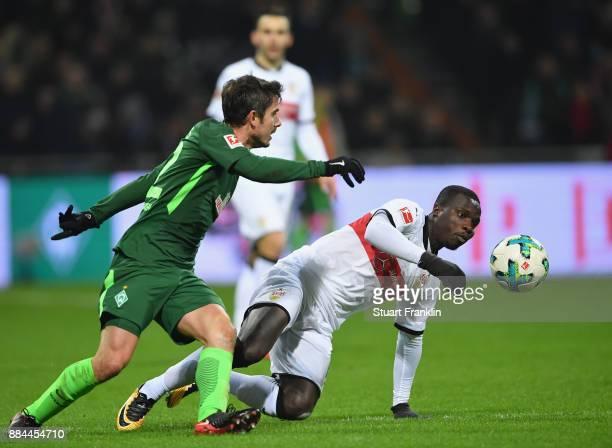 Fin Bartels of Bremen is challenged by Chadrac Akolo of Stuttgart during the Bundesliga match between SV Werder Bremen and VfB Stuttgart at...