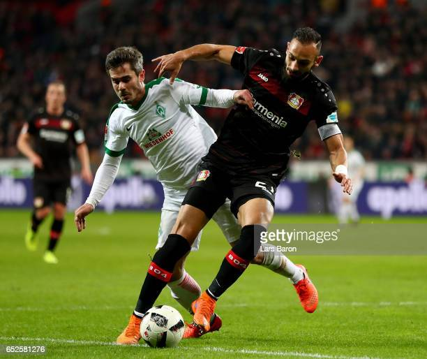 Fin Bartels of Bremen is challenged by Oemer Toprak of Bayer Leverkusen during the Bundesliga match between Bayer 04 Leverkusen and Werder Bremen at...