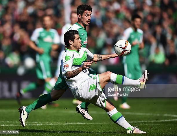 Fin Bartels of Bremen is challenged by Vierinha of Wolfsburg during the Bundesliga match between Werder Bremen and VfL Wolfsburg at Weserstadion on...