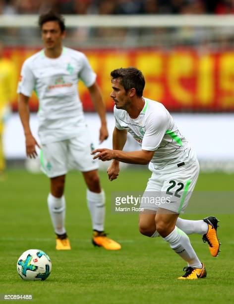 Fin Bartels of Bremen runs with the ball during the preseason friendly match between FC St Pauli and Werder Bremen at Millerntor Stadium on July 22...