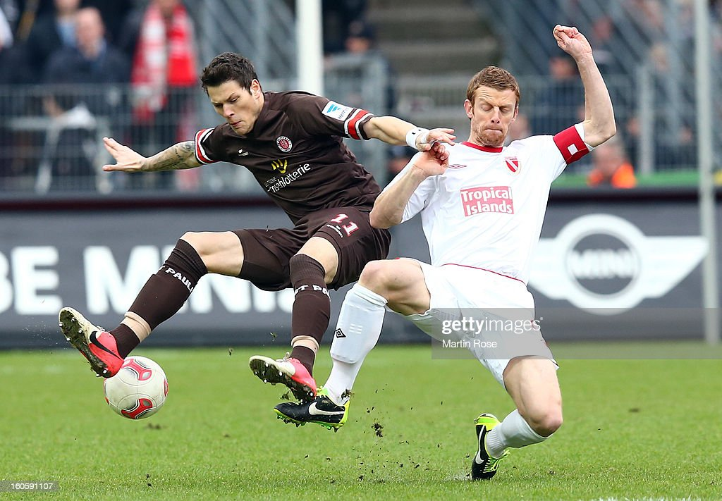 Fin Bartels (L) of St. Pauli and Uwe Moehrle (R) of Cottbus battle for the ball during the second Bundesliga match between FC St. Pauli and Energie Cottbus at Millerntor Stadium at Millerntor Stadium on February 3, 2013 in Hamburg, Germany.