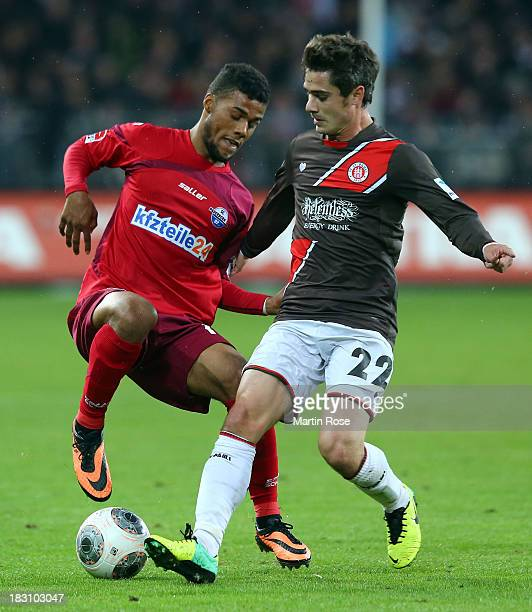 Fin Bartels of StPauli and Elias Kachunga of Paderborn battles for the ball during the Second Bundesliga match between FC St Pauli and SC Paderborn...