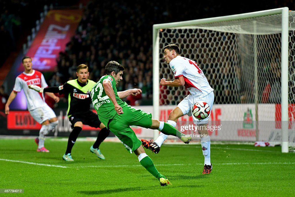 Fin Bartels of Werder Bremen has his shot on goal blocked by Jonas Hector of Koeln during the Bundesliga match between SV Werder Bremen and FC Koeln...