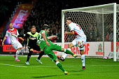 Fin Bartels of Werder Bremen has his shot on goal blocked by Jonas Hector of Koeln during the Bundesliga match between SV Werder Bremen and FC Koeln...