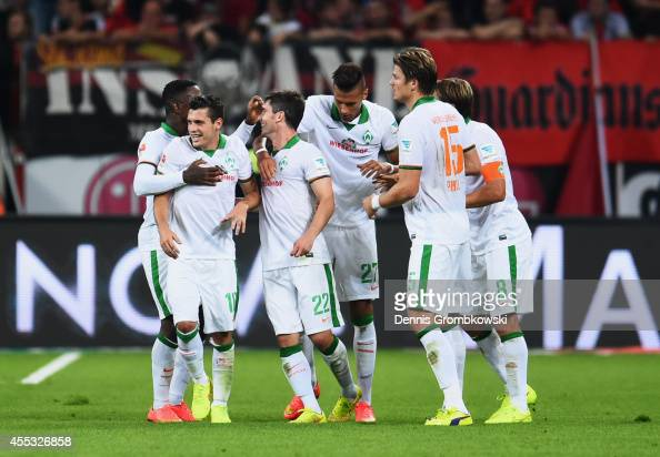 Fin Bartels of Werder Bremen is congraulated by team mates as he scores their first goal during the Bundesliga match between Bayer 04 Leverkusen and...