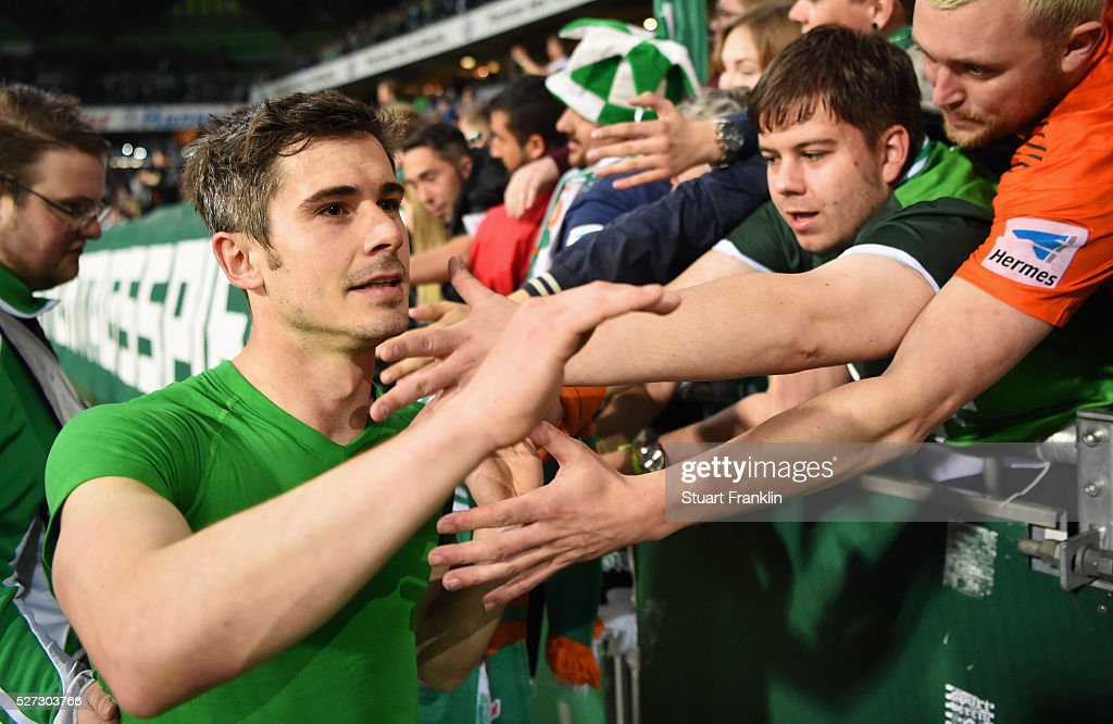 Fin Bartels of Werder Bremen shakes hands with fans after a 6:2 victory in the Bundesliga match between Werder Bremen and VfB Stuttgart at Weserstadion on May 2, 2016 in Bremen, Germany.