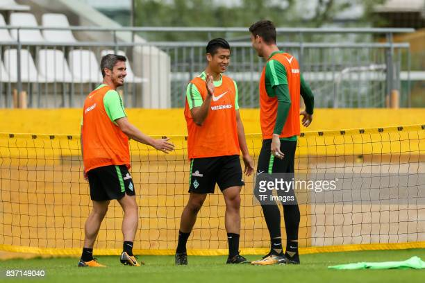 Fin Bartels of Werder Bremen Yuning Zhang of Werder Bremen and Goalkeeper Jiri Pavlenka of Werder Bremen looks on during the Training Camp of SV...