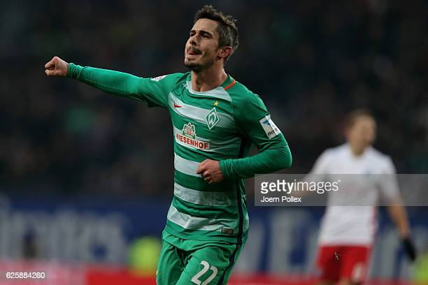 Fin Bartesl of Bremen celebrates after scoring his team's first goal during the Bundesliga match between Hamburger SV and Werder Bremen at...