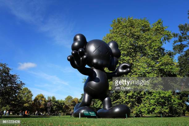 'Final Days' 2013 by KAWS during the Frieze Sculpture Fair in the Regents Park English Gardens as part of Frieze London on October 6 2017 in London
