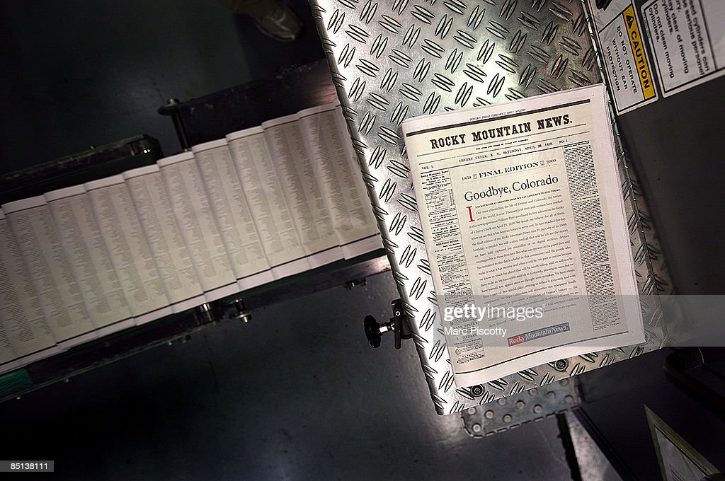 A final edition of the Rocky Mountain News sits atop a piece of the presses as others roll down a conveyor belt at the E.W. Estlow printing facility February 26, 2009 in Denver, Colorado. Scripps executives announced to employees that tomorrow's edition of the News would be its last after almost 150 years of publishing. The newspaper had been put up for sale by Scripps, but the search for a buyer proved unsuccessful. The closure will cost 228 newsroom employees their jobs.
