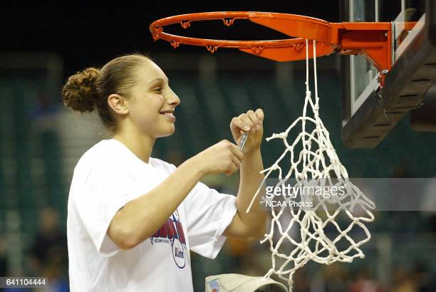 Final Four MVP Diana Taurasi of the University of Connecticut participates in the traditional net cutting after defeating the University of Tennessee...