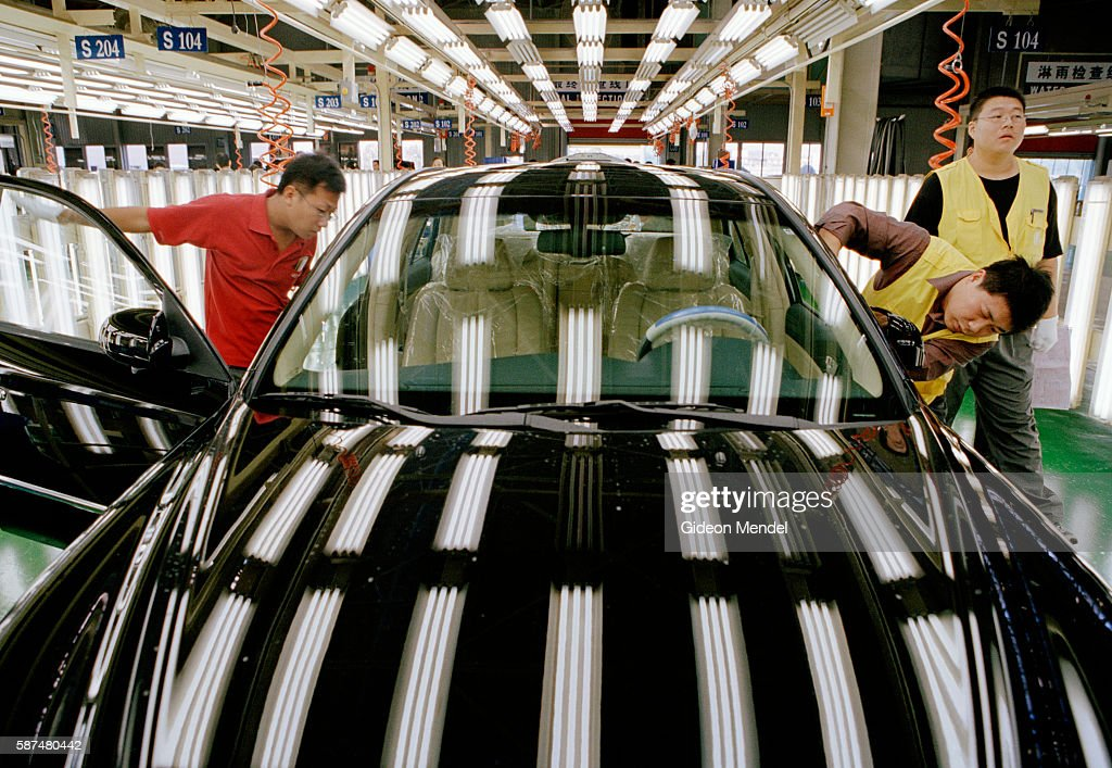 A final inspection of the completed bodywork as a new car rolls off the production line at the Hyundai factory in Beijing Despite the fact that...