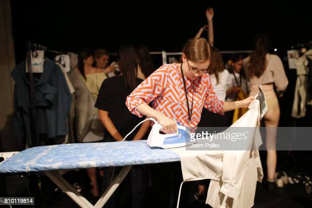Final preparations are made backstage ahead of the Vladimir Karaleev show during the MercedesBenz Fashion Week Berlin Spring/Summer 2018 at Kaufhaus...