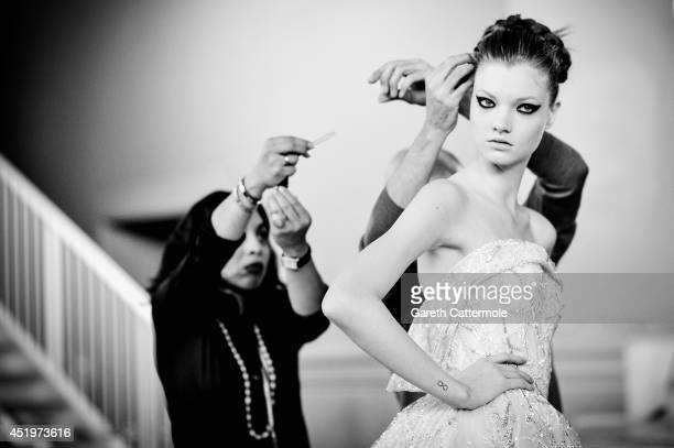 Final preparations are made to a model backstage before the Zuhair Murad show as part of Paris Fashion Week Haute Couture Fall/Winter 20142015 at...