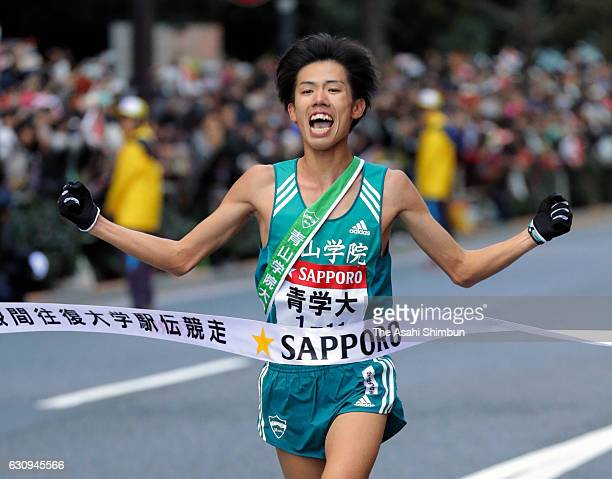 Final runner of Aoyama Gakuin University Yuya Ando celebrates as he crosses the finish tape to win during day two of the 93rd Hakone Ekiden on...