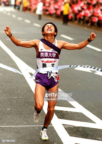 Final runner of Komazawa University Masahito Takahashi crosses the finish tape to win the 76th Hakone Ekiden on January 3 2000 in Tokyo Japan