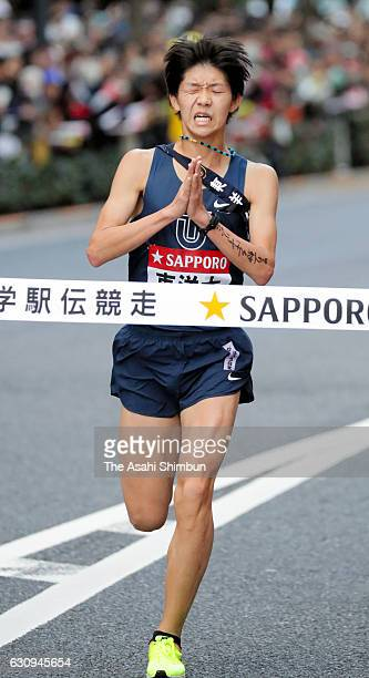 Final runner of Toyo University Takeru Kobayakawa crosses the finishing tape as second during day two of the 93rd Hakone Ekiden on January 3 2017 in...