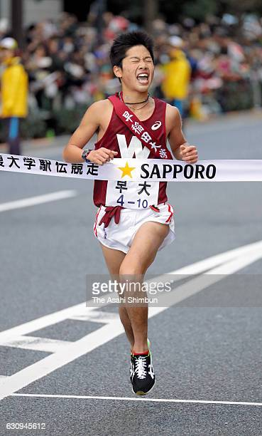 Final runner of Waseda University Kanta Shimizu crosses the finishing tape as third during day two of the 93rd Hakone Ekiden on January 3 2017 in...