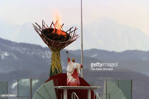 Final torch bearer and former figure skater Midori Ito lights the cauldron during the opening ceremony of the Nagano Winter Olympic Games at Minami...