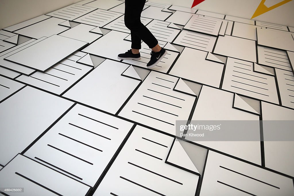 Final year art student Paul Schneider walks through his work entitled 'Office Party' on June 11, 2014 in London, England. The piece makes up part of the the annual 'RA Schools Show', which brings together work by final year students, and is currently running at the RA until June 29, 2014.