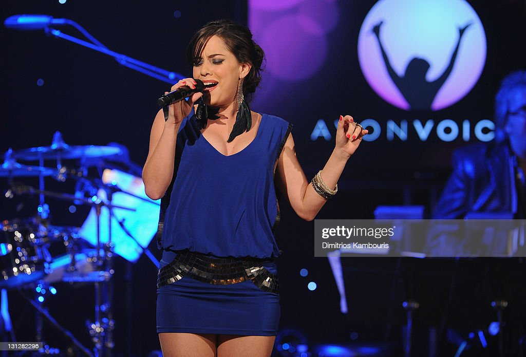 Finalist Claudia Santos Morandi performs onstage at the Avon Voices singing talent search Finale at Hard Rock Cafe, Times Square on November 1, 2011 in New York City.