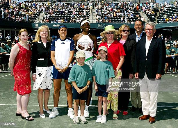 Finalist Conchita Martinez of Spain and champion Venus Williams pose with tournament organizers and government officials after their match during the...
